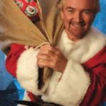 Noel Edmonds acting the cunt and dressed as Santa