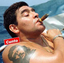 Diego Maradono, smoking a large cigar on a boat